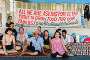 """11 MAY 2013 - BANGKOK, THAILAND:   Several hundred small scale family farmers camped out """"Government House"""" (the office of the Prime Minister) in Bangkok to Thai Prime Minister Yingluck Shinawatra to deliver on her promises to improve the situation of family farmers. The People's Movement for a Just Society (P-move) is a network organization which aims strengthen the voices of different, but related causes working to bring justice for marginalized groups in Thailand, including land rights for small-scale farmers, citizenship for stateless persons, fair compensation for communities forced to relocate to accommodate large scale state projects, and housing solutions for urban slum dwellers, among others.   PHOTO BY JACK KURTZ"""