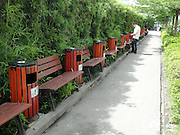 SHENZHEN, CHINA - JULY 27: (CHINA OUT) <br /> <br /> 100 Trash Cans Within 200 Meters<br /> <br /> Over 100 trash cans are seen besides every benches within a 200 meters path on July 27, 2014 in Shenzhen, Guangdong province of China. 100 Trash Cans were put besides every benches at a 200 meters path to help people develop a good habit of throwing trashes into trash cans on July 27, 2014 in Shenzhen, Guangdong province of China.<br /> ©Exclusivepix