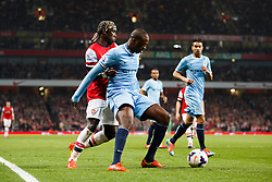 Man City Midfielder Yaya Toure (CIV) is challenged by Arsenal Defender Bacary Sagna (FRA) - Photo mandatory by-line: Rogan Thomson/JMP - 07966 386802 - 29/03/14 - SPORT - FOOTBALL - Emirates Stadium, London - Arsenal v Manchester City - Barclays Premier League.