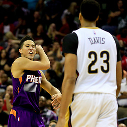 Nov 4, 2016; New Orleans, LA, USA; Phoenix Suns guard Devin Booker (1) celebrates after a basket against the New Orleans Pelicans during the second half of a game at the Smoothie King Center. The Suns defeated the Pelicans 112-111 in overtime. Mandatory Credit: Derick E. Hingle-USA TODAY Sports