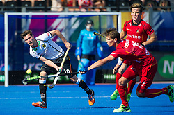 Belgium's Felix Denayer tries to intercept Martin Zwicker 's pass. Belgium v Germany - Unibet EuroHockey Championships, Lee Valley Hockey & Tennis Centre, London, UK on 22 August 2015. Photo: Simon Parker