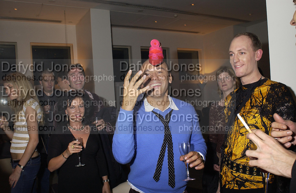 Christian Louboutin with a shoe on his head. party hosted by Harpers and Queen for Christian Louboutin 10 Anniversary. Met Bar. 16 October 2001. © Copyright Photograph by Dafydd Jones 66 Stockwell Park Rd. London SW9 0DA Tel 020 7733 0108 www.dafjones.com