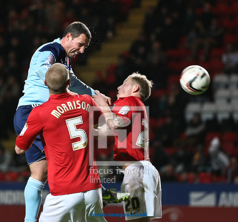 Picture by David Horn/Focus Images Ltd +44 7545 970036.03/11/2012.Michael Morrison and Chris Solly of Charlton Athletic and Scott McDonald of Middlesbrough (centre) during the npower Championship match at The Valley, London.