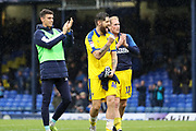 AFC Wimbledon midfielder Anthony Wordsworth (40), AFC Wimbledon midfielder Mitchell (Mitch) Pinnock (11) and AFC Wimbledon goalkeeper Nicola Tzanev (13) celebrating win during the EFL Sky Bet League 1 match between Southend United and AFC Wimbledon at Roots Hall, Southend, England on 12 October 2019.