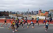 The elite mens runners cross the Pulaski Bridge into the Queens borough of New York during the New York City Marathon on Sunday, Nov. 3, 2013. (AP Photo/Kathy Kmonicek)