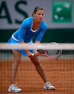 Alicja Rosolska of Poland competes at women's double game while Day Fifth during The French Open 2013 at Roland Garros Tennis Club in Paris, France.<br /> <br /> France, Paris, May 30, 2013<br /> <br /> Picture also available in RAW (NEF) or TIFF format on special request.<br /> <br /> For editorial use only. Any commercial or promotional use requires permission.<br /> <br /> Mandatory credit:<br /> Photo by © Adam Nurkiewicz / Mediasport