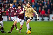 James Wilson (#28) of Aberdeen FC holds off Aaron Hickey (#51) of Heart of Midlothian FC during the Ladbrokes Scottish Premiership match between Heart of Midlothian FC and Aberdeen FC at Tynecastle Stadium, Edinburgh, Scotland on 29 December 2019.