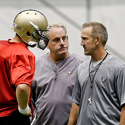 July 27, 2012; Metairie, LA, USA; New Orleans Saints quarterback Drew Brees (9) with assistant head coach and linebackers coach Joe Vitt and defensive coordinator Steve Spagnuolo during training camp at the team's indoor practice facility. Mandatory Credit: Derick E. Hingle-US PRESSWIRE