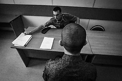 Young recruit passes the  commission during the call-up to the Russian army in Moscow, Russia, 15 June 2012.