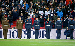 Members of the armed forces during a minutes silence for Armistice Day and also the victims of the Leicester helicopter crash, which included Leicester Chairman, Vichai Srivaddhanaprabha