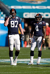 Virginia tight end Andrew Devlin (87) and Vic Hall (4) before the start of the Gator Bowl. The Texas Tech Red Raiders defeated the Virginia Cavaliers 31-28 in the 2008 Konica Menolta Gator Bowl held at the Jacksonville Municipal Stadium in Jacksonville, FL on January 1, 2008.