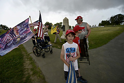 People leave the Civil War battlegrounds in Gettysburg, Pennsylvania, ahead of a storm, on July 1st, 2017. Patriotic activist, including Sons of the Confederate Veterans and Real 3% Risen, staged multiple free speech rallies opposing a rumored anti-fascist confederate flag burning on the 154th anniversary of the historic Civil War battle.