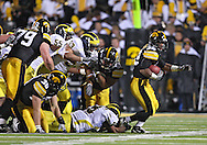 October 10, 2009: Iowa running back Adam Robinson (32) carries the ball during the first half of the Iowa Hawkeyes' 30-28 win over the Michigan Wolverine's at Kinnick Stadium in Iowa City, Iowa on October 10, 2009.