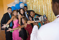 Group of Teenagers Hamming It Up for Prom Photo