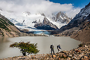 Cerro Solo (left) rises above Laguna Torre (634 m or 2080 ft) in Los Glaciares National Park, near El Chalten mountain resort in Santa Cruz Province, Argentina, Patagonia, South America. We hiked 21 km (13 miles) round trip with 730 m (2400 ft) cumulative gain to Laguna Torre and Mirador Maestri, which is at the top of the lateral moraine at right. Los Glaciares National Park and Reserve are honored on UNESCO's World Heritage List.