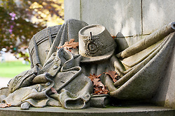 Carving of Drum, Standard Cap and uniform of the York & Lancaster regiment on the York & Lancaster War Memorial in Weston Park Sheffield<br />
