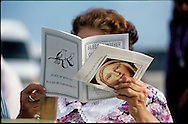 DADE CITY, FLORIDA: A woman reads through a bulletin at the site of a Virgin Mary apparition at the home of Vimer Nagun in Dade City, Florida. Thousands of people arrived in this rural community with the hopes of witnessing the apparition for themselves.  (Photo by Robert Falcetti).