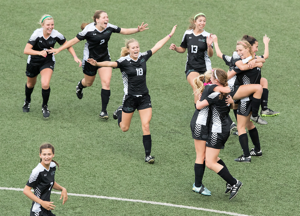 The Omaha Skutt SkyHawks celebrate after defeating Columbus Scotus 3-0 in the Class B girls state final. Omaha Skutt played Columbus Scotus in the Class B girls Nebraska state soccer championship at Morrison Stadium on Wednesday, May 17, 2017, in Omaha.<br /> <br /> MATT DIXON/THE WORLD-HERALD