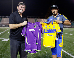 12 July 2016. New Orleans, Louisiana.<br /> NPSL Soccer, Pan American Stadium.<br /> Head coach Kenny Farrell of the New Orleans Jesters prepares to swap shirts with UANL Tigres from Monterrey, Mexico. <br /> Jesters draw 1-1 at full time, going on to lose the penalty shoot out.<br /> Photo; Charlie Varley/varleypix.com