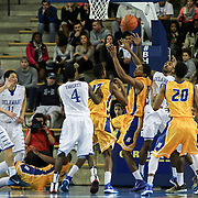 Delaware Guard Davon Usher (0) and Hofstra Forward Jordan Allen (0) battle for the loose ball in the first half of a NCAA regular season Colonial Athletic Association conference game between Delaware and Hofstra Wednesday, JAN 8, 2014 at The Bob Carpenter Sports Convocation Center in Newark Delaware.