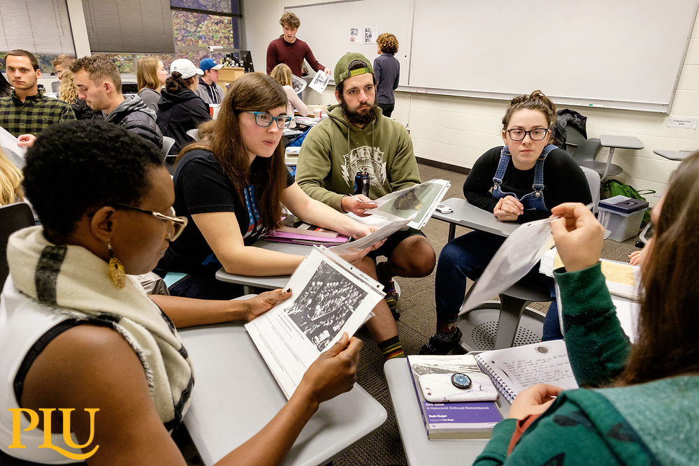 Students study reproductions of artifacts from the Holocaust Center for Humanity brought by Ilana Conne Kennedy to a history class taught by Prof. Lisa Marcus at PLU, Wednesday, Nov. 8, 2017.  (Photo: John Froschauer/PLU)