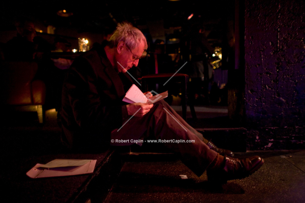 Current US poet laureate Charles Simic, sits off-stage while listening to jazz between readings of some poetry during a collaboration with jazz musicians at the Jazz Standard in New York, U.S. 1/8/08.