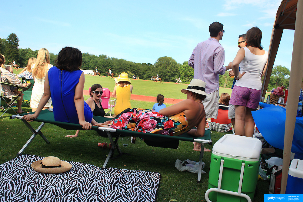 Spectators watch the Polo during the Airstream vs. Cinque Terre Polo match at the Greenwich Polo Club, Greenwich, Connecticut, USA. 23rd June 2013. Photo Tim Clayton
