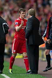 LIVERPOOL, ENGLAND - Saturday, April 23, 2011: Liverpool's Jack Robinson and manager Kenny Dalglish during the Premiership match against Birmingham City at Anfield. (Photo by David Rawcliffe/Propaganda)
