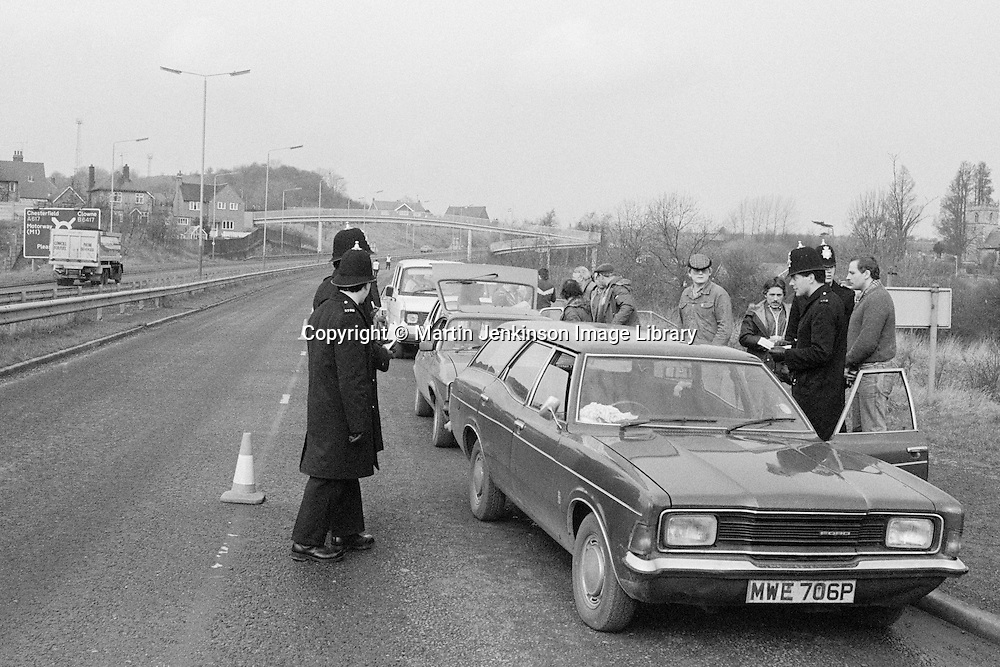 Miners pickets stopped at a Police road block at Pleasley on the Nottinghamshire border with Derbyshire. 28 March 1984