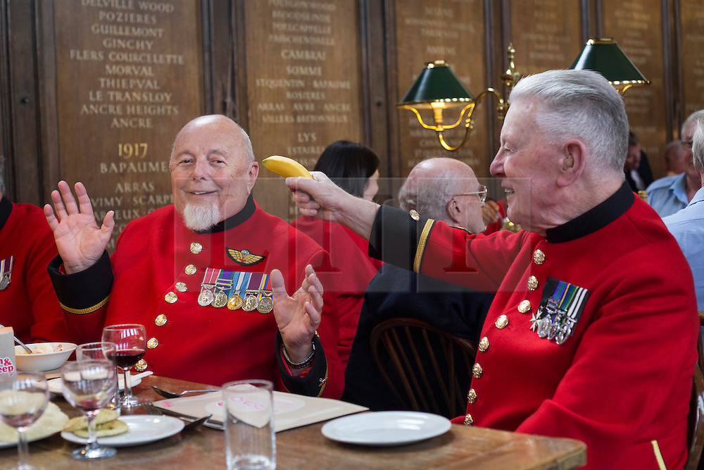 © licensed to London News Pictures. London, UK 02/10/2012. David Donaghey, 86, pointing a banana lika a gun to Wayne Campbell, 75, whilst Chelsea Pensioners launch The Soldiers' Charity Big Curry season with a special a curry lunch at Royal Hospital Chelsea's Royal Hall in London on 02/10/12. Photo credit: Tolga Akmen/LNP