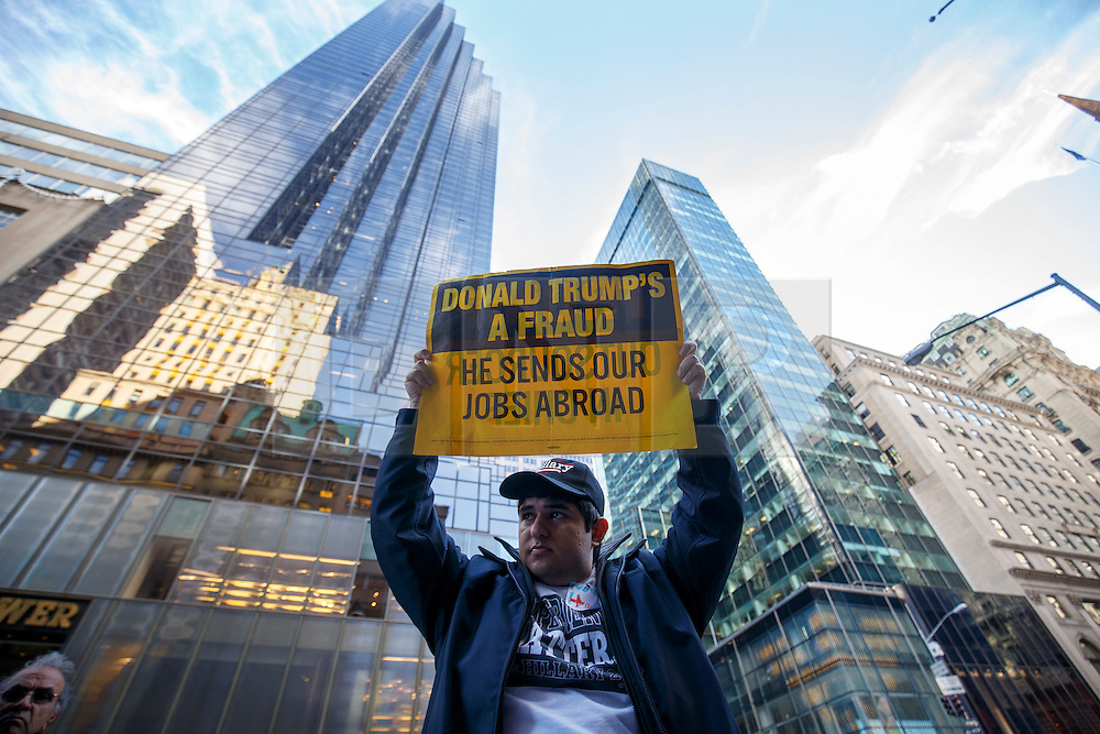 © Licensed to London News Pictures. 08/11/2016. New York CIty, USA. A pro-Hillary Clinton and Democrat supporter campaigns outside Trump Tower in New York City on Tuesday, 8 November, the day of the presidential election in the United States of America. Photo credit: Tolga Akmen/LNP