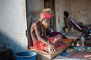 Old skinny sadhu living in the streets of Pushkar (India)