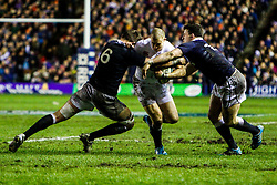 © Licensed to London News Pictures. 08/02/2014. Edinburgh, Scotland. <br /> Mike Brown (ENG) breaking through the Scottish defense.<br />  Scotland take on England for the Calcutta cup at the RBS 6 Nations rugby tournament at Murrayfield in Edinburgh.  Photo credit : Duncan McGlynn/LNP