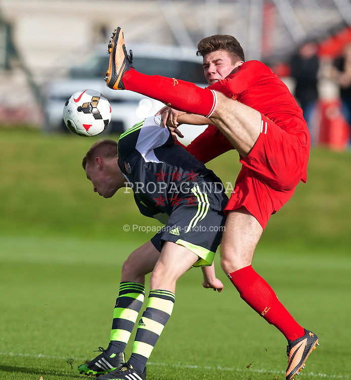 LIVERPOOL, ENGLAND - Saturday, November 9, 2013: Liverpool's Joe Maguire in action against Stoke City's Jake Cook during the Premier League Academy match at the Kirkby Academy. (Pic by David Rawcliffe/Propaganda)
