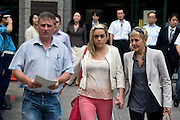 Nicola Furlong's family (L-R) father Andrew, sister,  Andrea, and mother, Angela, leave the Tokyo Family Court in Tokyo, Japan on 26 July, 2012. Photographer: Robert Gilhooly