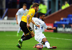 Bristol Rovers' Matty Taylor is challenged by Tranmere Rovers's Michael Ihiekwe - Photo mandatory by-line: Neil Brookman/JMP - Mobile: 07966 386802 - 08/11/2014 - SPORT - Football - Birkenhead - Prenton Park - Tranmere Rovers v Bristol Rovers - FA Cup - Round One