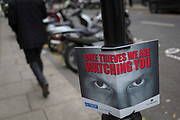 A pair of eyes warn ever-present bike and scooter thieves that they're being watched by the Met Police, on 22nd November 2017, in London England.