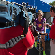 August 19, 2014, New Haven, CT:<br /> Andrea Petkovic is interviewed as she bikes on the spin bike to raise money for Yale New Haven Health on day five of the 2014 Connecticut Open at the Yale University Tennis Center in New Haven, Connecticut Tuesday, August 19, 2014.<br /> (Photo by Billie Weiss/Connecticut Open)