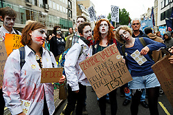 © Licensed to London News Pictures. 10/07/2014. LONDON, UK. Young people dressed as zombies marching from BBC Broadcasting House to Trafalgar Square in central London to protest in a series of disputes with the government over pay, pensions and cuts, with more than a million public sector workers expected to join the action across the UK. Photo credit : Tolga Akmen/LNP
