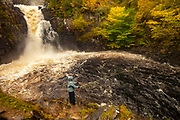 Fisherwoman casts for salmon, Kirkaig falls, near Suilven, autumn in the The Highlands, NW Scotland
