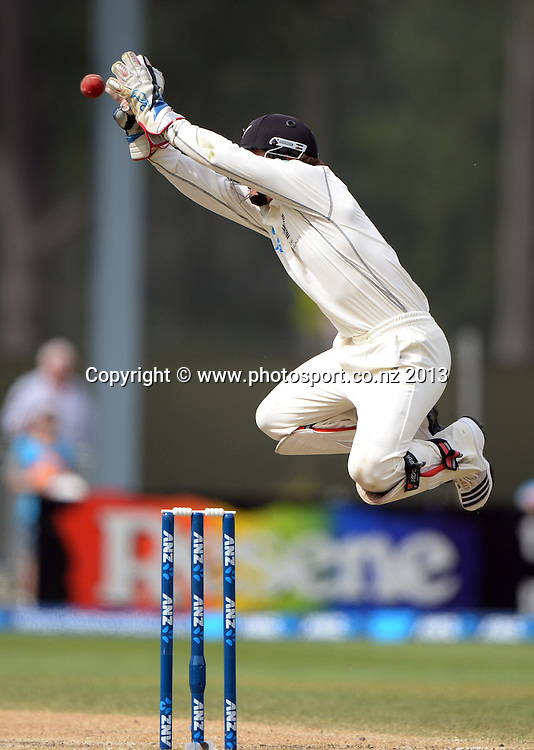 BJ Watling takes a return from the field on Day 4 of the 1st cricket test match of the ANZ Test Series. New Zealand Black Caps v West Indies at University Oval in Dunedin. Friday 6 December 2013. Photo: Andrew Cornaga/www.Photosport.co.nz