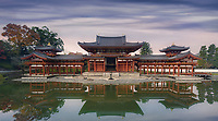 Beautiful Amida Hall of Byodoin Japanese Buddhist temple reflecting in the water of Jodoshiki Pure Land garden pond in a peaceful autumn morning scenery. Byodo-in, Uji, Kyoto Prefecture, Japan 2017
