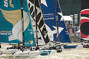Oman Air, Emirates Team New Zealand and Realstone in a race start. Day four of the Extreme Sailing Series regatta being sailed in Singapore. 23/2/2014