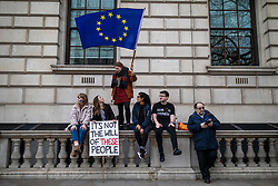 "© Licensed to London News Pictures. 23/03/2019. London, UK. Protesters on Whitehall as an estimated one million people march through central London to demand that government allow a ""People's Vote"" on the Brexit deal. Several key votes will be held in Parliament in the coming week. Photo credit: Rob Pinney/LNP"