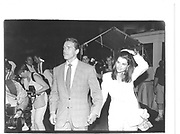 Arnold Swarzeneggar and Maria Schriver at Gracie Mansier party.Sun. New York 1990 approx.© Copyright Photograph by Dafydd Jones 66 Stockwell Park Rd. London SW9 0DA Tel 020 7733 0108 www.dafjones.com