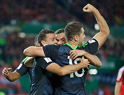 VIENNA, AUSTRIA - Thursday, October 6, 2016: Wales' James Chester celebrates scoring the second goal against Austria during the 2018 FIFA World Cup Qualifying Group D match at the Ernst-Happel-Stadion. (Pic by David Rawcliffe/Propaganda)