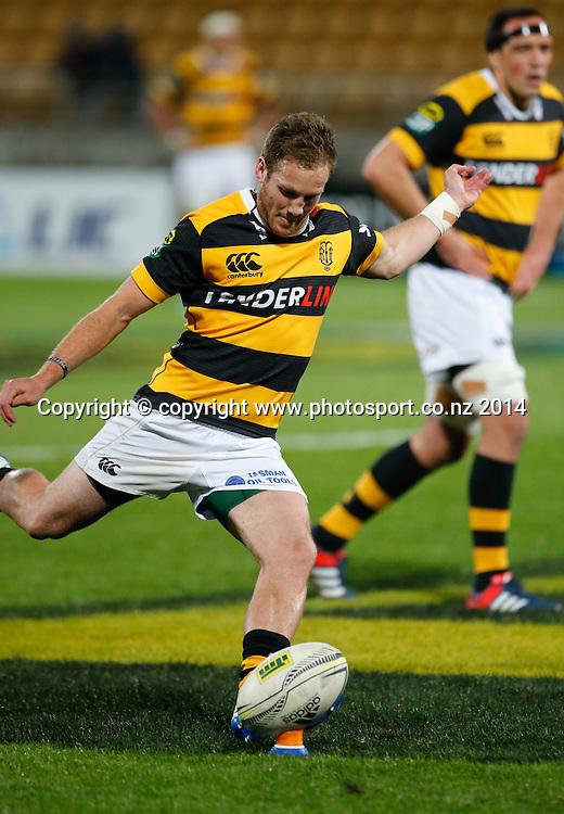 Taranaki's Marty McKenzie kicks. ITM Cup Rugby, Taranaki v Auckland, Yarrow Stadium, New Plymouth, New Zealand. Friday, 26 September, 2014. Photo: John Cowpland / www.photosport.co.nz