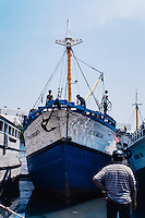 Java, East Java, Surabaya. Vessel leaving Kalimas harbor.