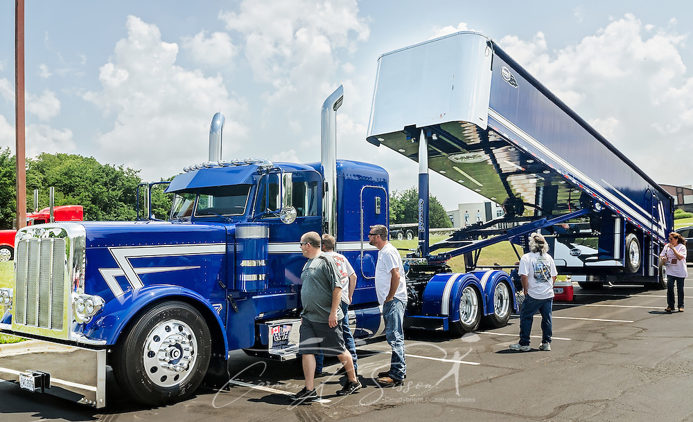 Truck enthusiasts examine HLH Trucking's 2015 Peterbilt 389 with a 2017 MAC End Dump during the 34th annual Shell Rotella SuperRigs truck beauty contest, June 11, 2016, in Joplin, Missouri. SuperRigs, organized by Shell Oil Company, is an annual beauty contest for working trucks. Approximately 89 trucks entered this year's competition. (Photo by Carmen K. Sisson/Cloudybright)