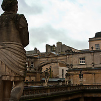 Roman statue overlooking the baths at Bath, England.
